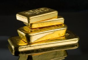 As Dow Limps into the New Year, Gold Is Regaining Its Shine